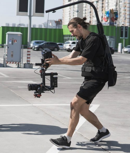 Image of our staff at Elite Video of Portland shoowing some footage out in a parking lot.